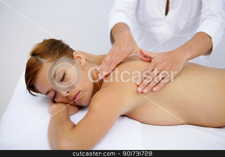 Woman receiving back massage stock photo, Woman receiving back massage by photography33