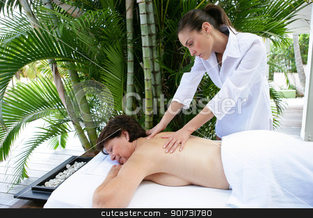 Woman receiving soothing back massage stock photo, Woman receiving soothing back massage by photography33