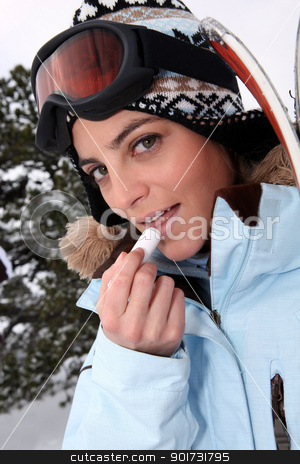 Skier applying lip balm stock photo, Skier applying lip balm by photography33