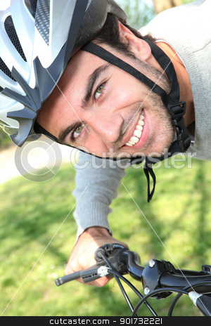 Young man having a bike ride stock photo, Young man having a bike ride by photography33
