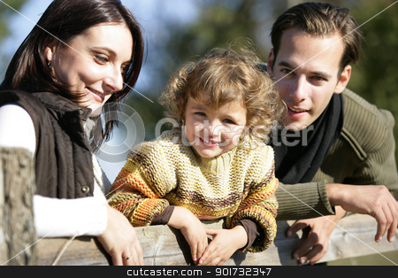 Young family leaning against fence stock photo, Young family leaning against fence by photography33