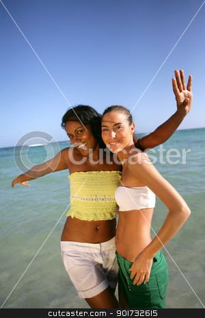 Two female friends at the seaside stock photo, Two female friends at the seaside by photography33