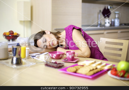 woman asleep on kitchen table during breakfast stock photo, female model sleeping on kitchen table in front of breakfast by federico marsicano