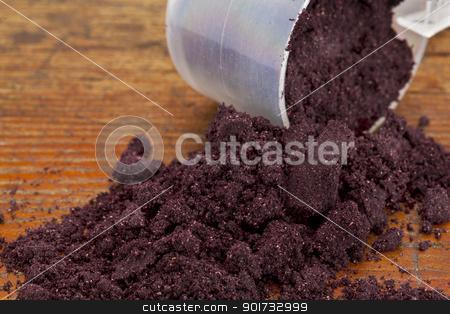 maqui fruit powder stock photo, a measuring cup of organic freeze-dried maqui fruit (Aristotelia Chilensis) powder on a grunge wooden background by Marek Uliasz