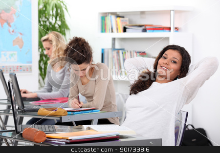Girl relaxing in class stock photo, Girl relaxing in class by photography33