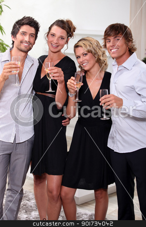 Two young couples drinking champagne stock photo, Two young couples drinking champagne by photography33