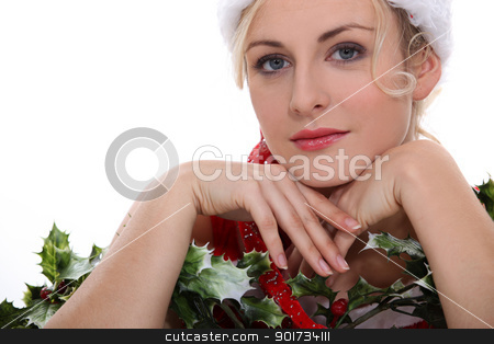 Woman with holly stock photo, Woman with holly by photography33