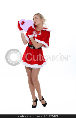 Blond woman dressed in suggestive Christmas costume stock photo, Blond woman dressed in suggestive Christmas costume by photography33