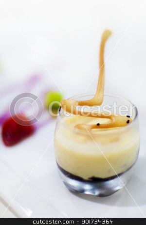 Dessert (Pistachio Semifreddo) stock photo, A creamy dessert with crushed pistachio nuts and chocolate ganache, served with fresh caramel fruits by szefei