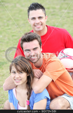 Young people playing soccer in a park stock photo, Young people playing soccer in a park by photography33