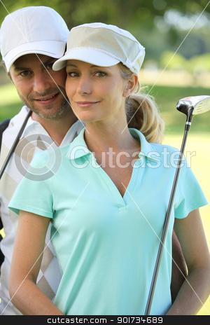 Couple golfing stock photo, Couple golfing by photography33