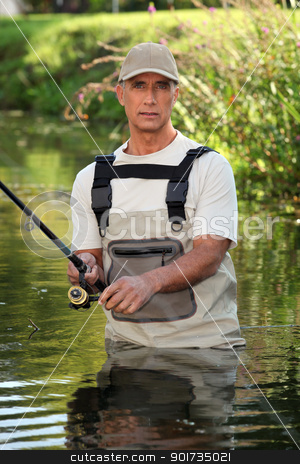Fisherman wading in river stock photo, Fisherman wading in river by photography33