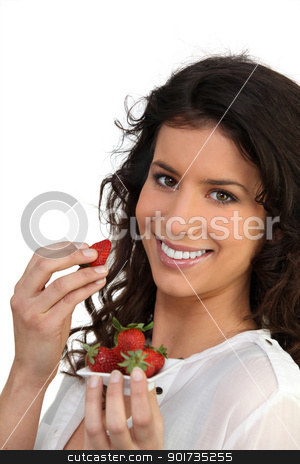 Smiling woman eating strawberries stock photo, Smiling woman eating strawberries by photography33