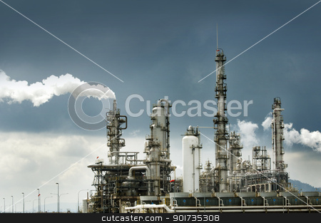 Oil refinery with smoke stock photo, Oil refinery with smoke against moody sky by szefei
