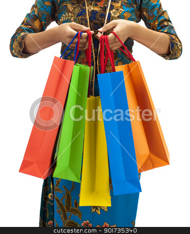 Asia shopping paradise stock photo, Woman in tradition Kebaya holding colorful shopping bag. by szefei