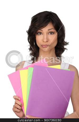 Woman perplexed at her office files stock photo, Woman perplexed at her office files by photography33