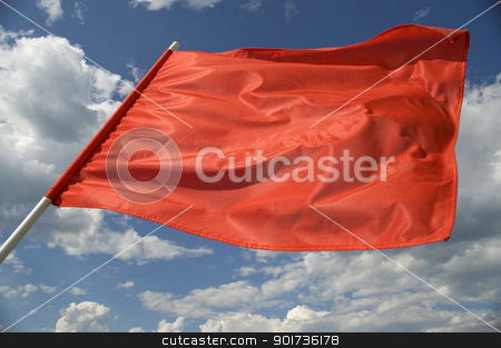 Red flag. stock photo, Red flag on a background of the dark blue sky with clouds. by Yury Ponomarev