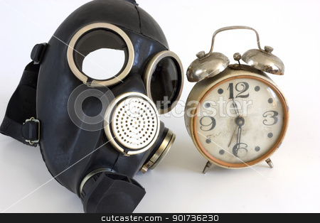 Gas mask. stock photo, The Gas mask and old watch on white background. by Yury Ponomarev