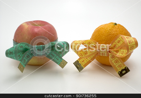 Symbol of diet and healthy eating. stock photo, Apple and  bright orange  with measuring tape. by Yury Ponomarev