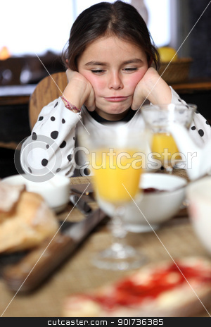 Grumpy girl at breakfast stock photo, Grumpy girl at breakfast by photography33