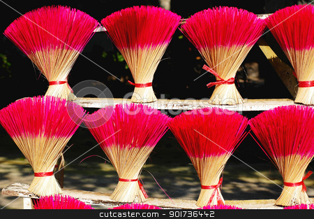 Red incense or joss sticks for buddhist prayers stock photo, Red incense or joss sticks for buddhist prayers in Vietnam  by John Young