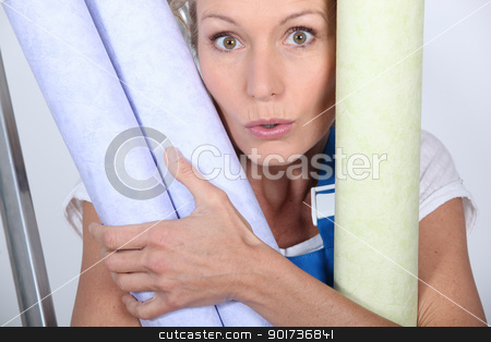 Closeup of woman with rolls of wallpaper stock photo, Closeup of woman with rolls of wallpaper by photography33