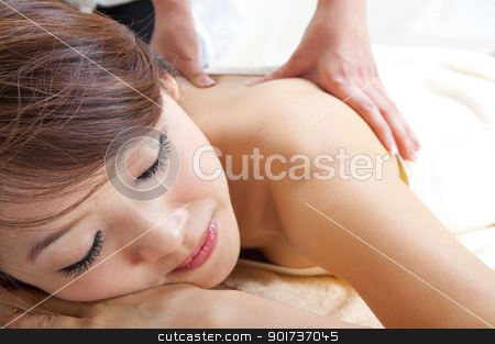 Back massage stock photo, Beauty and Spa - Asian Girl having a massage on her back by szefei