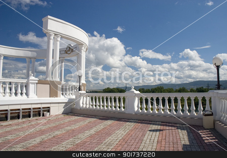 Arch with white columns and balustrade. stock photo, Arch with white columns on a background of the dark blue sky. by Yury Ponomarev