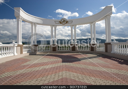 Arch with white columns. stock photo, Arch with white columns on a background of the dark blue sky. by Yury Ponomarev
