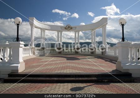 Balcony with white columns. stock photo, Balcony with white columns on a background of the sky with clouds. by Yury Ponomarev