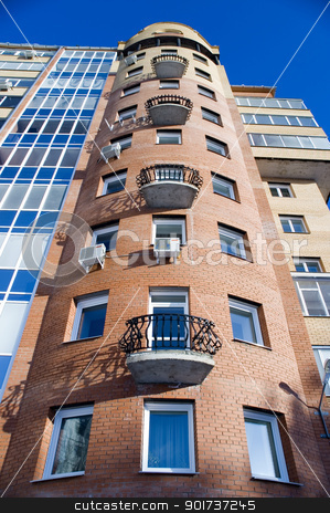 Modern Architecture stock photo, Modern building from a brick. Glass balconies. by Yury Ponomarev