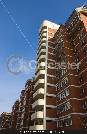 Modern Condominium. stock photo, Modern building from a brick. by Yury Ponomarev