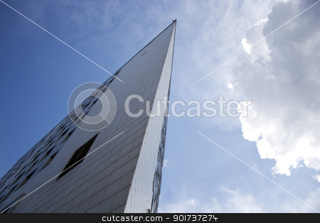 Modern Architecture. stock photo, The Modern town building on background sky with cloud. by Yury Ponomarev