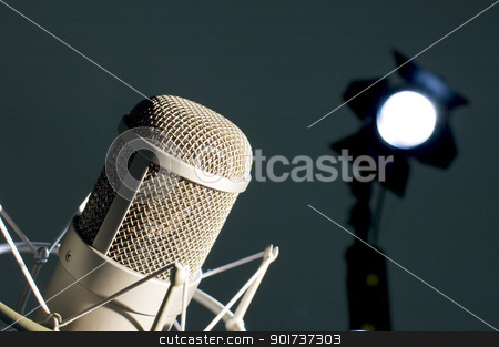 Microphone in studio. stock photo, Microphone in studio on a dark background. by Yury Ponomarev
