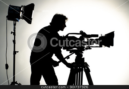 Studio Lighting. stock photo, Searchlight and silhouette of the camera and cameraman. by Yury Ponomarev