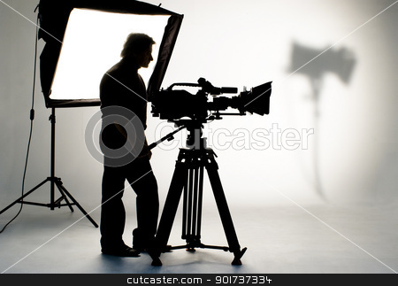 Studio light on location for movie scene. stock photo, Cameraman silhouette and cameras. by Yury Ponomarev