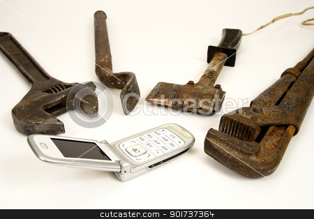 Tools and telephone. stock photo, Old  tools and modern telephone. by Yury Ponomarev