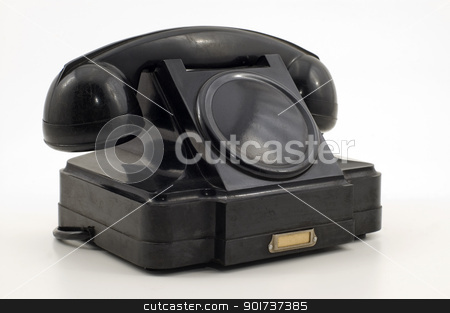 Old Phone. stock photo, Old-fashioned black telephone receiver with cord on white background. by Yury Ponomarev