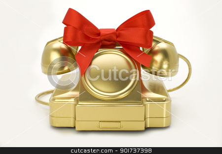The telephone of gold colour with a red tape. stock photo, The telephone of gold colour with a red tape on a white background. by Yury Ponomarev