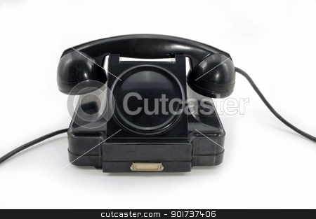 Old Phone stock photo, Old-fashioned black telephone receiver with cord on white background. by Yury Ponomarev