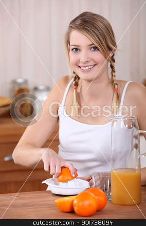 Woman pressing oranges. stock photo, Woman pressing oranges. by photography33