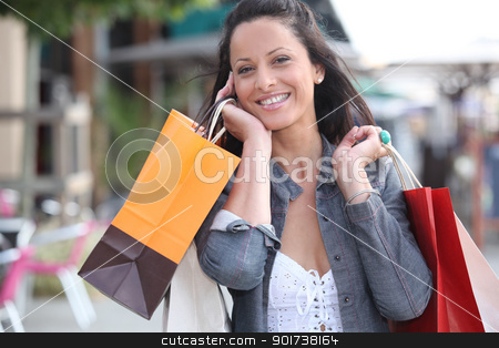 Woman with shopping bags stock photo, Woman with shopping bags by photography33