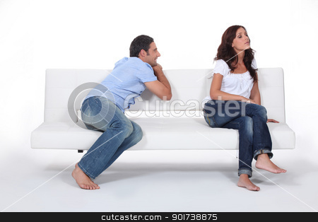 Man apolgising to woman on couch stock photo, Man apolgising to woman on couch by photography33