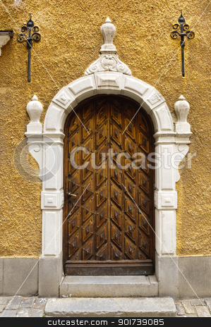 Old wooden door stock photo, Frontal view of a wooden old door in Stockholm old town by Alessandro Rizzolli