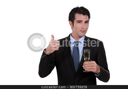 Businessman holding a glass of champagne stock photo, Businessman holding a glass of champagne by photography33