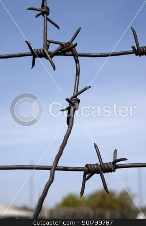 Barbed wire. stock photo, Barbed wire on the blue sky background. by Yury Ponomarev