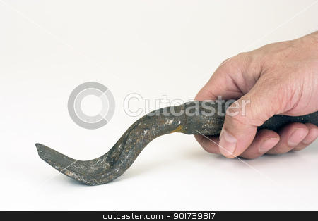 The iron tool. stock photo, The iron tool in a hand on a white background. by Yury Ponomarev