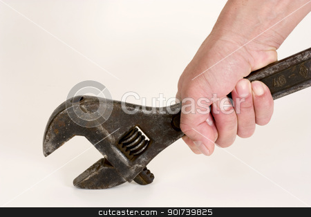 Spanner in Hand. stock photo, Old spanner in a hand on a light background. by Yury Ponomarev