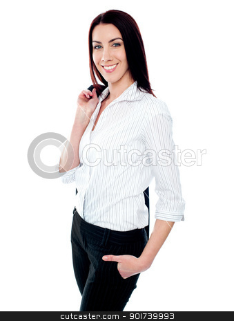 Stylish female executive holding coat over her shoulders stock photo, Stylish female business executive holding coat over her shoulders on white background by Ishay Botbol   