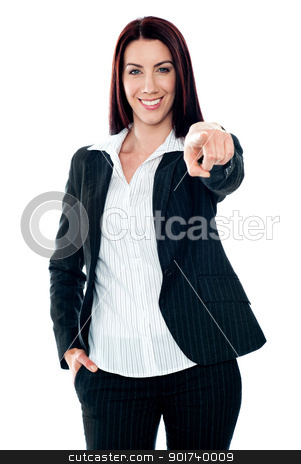 Smiling corporate lady pointing at you stock photo, Smiling corporate lady pointing at you against white background by Ishay Botbol